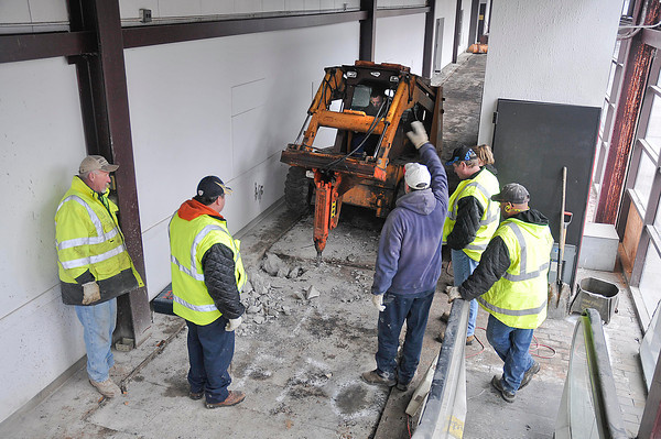 James Neiss/staff photographerNiagara Falls, NY - Niagara Falls DPW workers break up the concrete to get at the utilities inside the pedestrian walkway on Old Falls Street that used to be connected to the Rainbow Mall by a footbridge over 1st Street. Director of Public Works Dave Kinney, said they are removing the utilities in preparation for the enclosures demolition.