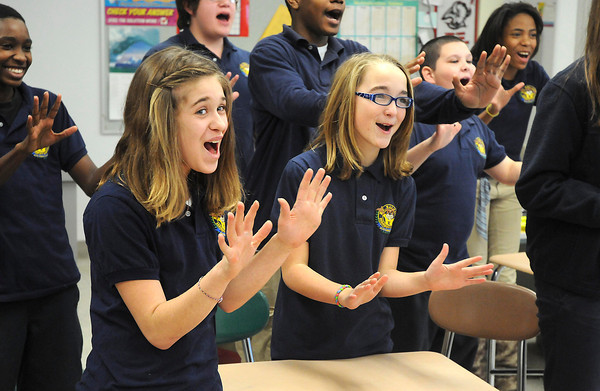 "James Neiss/staff photographerNiagara Falls, NY - Henry J. Kalfas Magnet School 6th grade students Laura Martinez, left, and Grace Schwerinski, right, join classmates in gesturing with both hands and saying the word ""stop"" loudly.  Niagara Falls Police Officer Dave Cudahy, said this is one of techniques used to get a potential bully's attention and notifying them that their actions are unacceptable. Cudahy held an anti-bullying session at the school for fifth and sixth graders."
