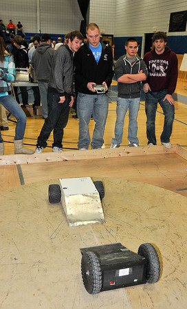 "James Neiss/staff photographerSanborn, NY - Tonawanda High School Students, from left, Justin Bacon, Andy Smith and Robert Peititt pit their robot ""Steam Roller"" against a Grand Island competitor during the Sumo Wrestling Robots competition during the 2012 Tech Wars at Niagara County Community College."