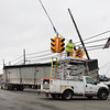 James Neiss/staff photographerNiagara Falls, NY - Niagara Falls utility crews take down the traffic lights at the intersection of Packard and New Roads after a truck clipped a utility pole at the corner.