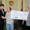 James Neiss/staff photographerNiagara Falls, NY - National Grid Senior Arborist Brian Skinner, right, presents a check to Mayor Paul Dyster and City Arborist Paul Dickinson at City Hall on Monday.