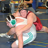 James Neiss/staff photographerSanborn, NY - Rion Elson of Starporint, top, wrestles Kevin McMurray of Lewport in the 285 pound weight class during the 2012 Niagara Frontier Wrestling Officials Association Annual tournament at Niagara County Community College.