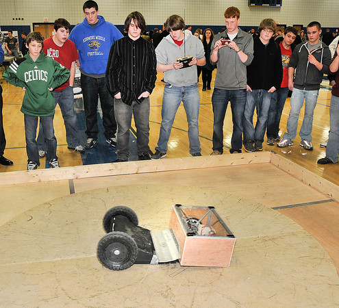 "James Neiss/staff photographerSanborn, NY - Lewiston-Porter High School student Cullen Ball uses a remote to control his teams robot ""The Dominator"" during the Sumo Wrestling Robots competition against a Grand Island High School opponent at the 2012 Tech Wars at Niagara County Community College."