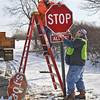 James Neiss/staff photographerTown of Niagara, NY - Town of Niagara Hi Way Department workers Robert Bridgeman and Joe White replace a faded stop sign at the intersection of Colonial Drive and Garlow Road. White, said the Town hand refurbishes the old signs using a high-tech 3M product.