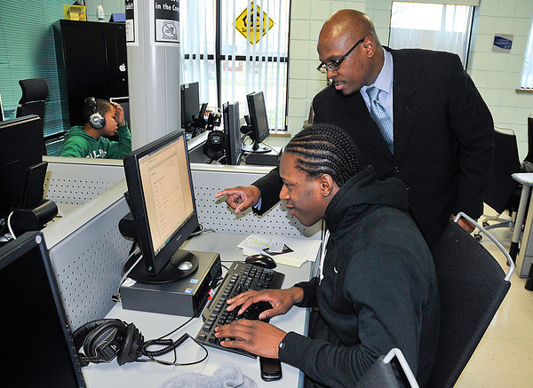 James Neiss/staff photographerNiagara Falls, NY - Howard Patton III, Coordinator of the SUNY ATTAIN Lab at the Niagara Falls Housing Authority Doris W. Jones Family Resource Building, right, works with Shevah Sheppard, 19, who is applying for a job online.  ATTAIN (Advanced Technology Training and Information Networking) is a statewide technology-based employment initiative funded by the New York State Legislature. The lab offers training in Adobe Photoshop, Dreamweaver and Premier, Microsoft Office software, Quick Books bookkeeping software and more.