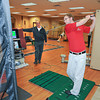 James Neiss/staff photographerNiagara Falls, NY - Sid Penque, left, and Jake Porsch, right, demonstrate the Dynamic Balance System used to provide real-time computer assisted feedback by monitoring a client's golf swing performance. Advanced Care, on Main Street, uses the data to map out a plan to improve their motion with physical therapy.