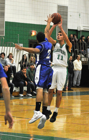 James Neiss/staff photographerLewiston, NY - Lewiston-Porter High School basketball player #11 John Dziewit puts the ball up past Kenmore West #2 Marcus Lobdell during the first quarter of basketball action in Lewiston.
