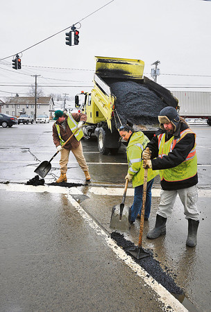 James Neiss/staff photographerNiagara Falls, NY - Niagara Falls DPW workers, from left, Jason Klein, Toni Manzare and John Rosino put down cold patch on Lockport Road at the intersection of Hyde Park Boulevard on Thursday.