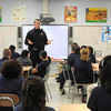 James Neiss/staff photographerNiagara Falls, NY - Niagara Falls Police Officer Dave Cudahy tells students every body deserves to feel happy, during an anti-bullying talk at Henry J. Kalfas Magnet School.