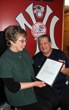 James Neiss/staff photographerWheatfield, NY - James Joyce surprised Barbara Marcolini and her family with a letter from the New York Yankees commemorating the loyalty of her deceased husband John. James Joyce and John Marcolini were longtime friends and huge fans of the Yankees.