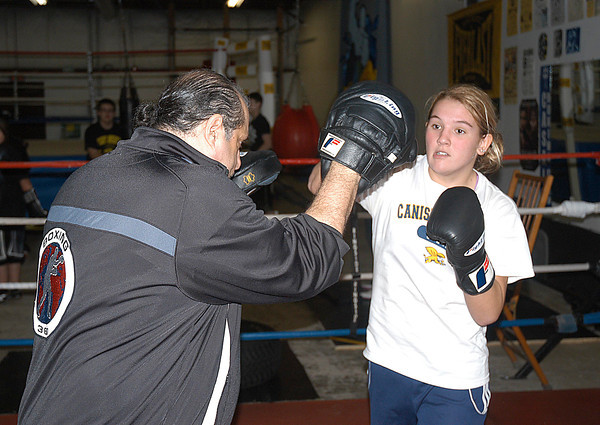 James Neiss/staff photographerNiagara Falls, NY - Golden Gloves boxer Brianna Smith of Wheatfield spars with Ray Casal during practice at Casal's Boxing Club on Maryland Avenue.