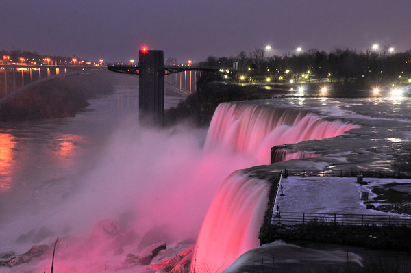 James Neiss/staff photographerNiagara Falls, NY - Colored lights shine on the American Falls and Prospect Point as seen from Goat Island.