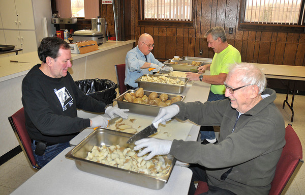 James Neiss/staff photographerWheatfield, NY - Adams Volunteer Fire Company volunteers, from left, Dennis Raczyk, David Messler, Jerry McCormick and Ed Sheliga, shop up potatoes for home fries on Saturday for the Adams Volunteer Fire Company in preparation for the Farmers Breakfast on Sunday. The fire department holds a farmers breakfast on the second Sunday of every month featuring all you can eat eggs, sausage, fruit, pancakes, ham, French toast, coffee and more inside their fire hall at 7113 Nash Road.