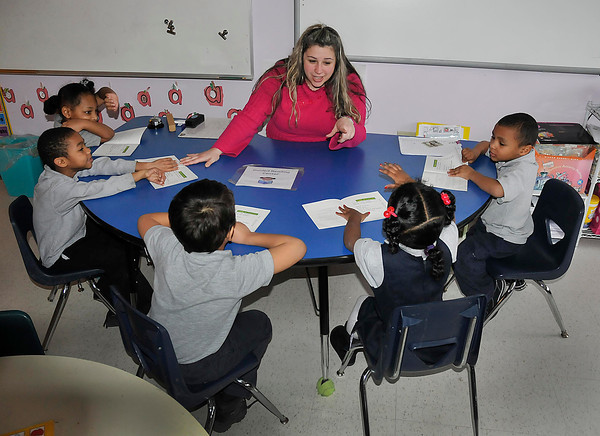 James Neiss/staff photographerTown of Niagara, NY - Kindergarten teacher Sherrie Kerl works with her students at the Niagara Charter School.
