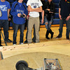 James Neiss/staff photographerSanborn, NY - Grand Island High School students Michael Fitzgerald, with remote, and team mate Tom Grenke, right, battle Lewiston-Porter during the SUMO Wrestling Robots competition at the 2012 Tech Wars at Niagara County Community College.