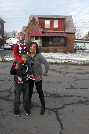 James Neiss/staff photographerNiagara Falls, NY - Tanisha Jackson and her son's Nizir 10, and Aveon, 4, are happy home owners on Elmwood Avenue, after taking advantage of the Neighborhood Housing Services program.