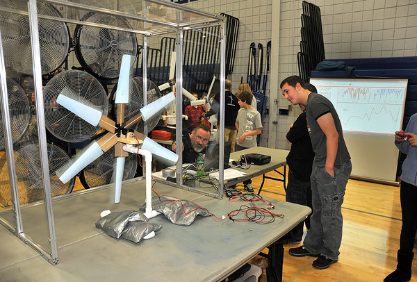 James Neiss/staff photographerSanborn, NY - Kidwind Project Teacher and Trainer Andy Lueth, left, comments on a wind generating project by Louis Rizzo of Niagara Wheatfield, right, as he takes electrical readings in a wind tunnel during the 2012 Tech Wars at Niagara County Community College.