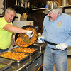 James Neiss/staff photographerWheatfield, NY - Adams Volunteer Fire Company volunteers, from left, Jerry McCormick and Keith Lange cook up some home fries on Saturday for the Adams Volunteer Fire Company Farmers Breakfast on Sunday. The fire department holds a farmers breakfast on the second Sunday of every month featuring all you can eat eggs, sausage, fruit, pancakes, ham, French toast, coffee and more inside their fire hall at 7113 Nash Road.