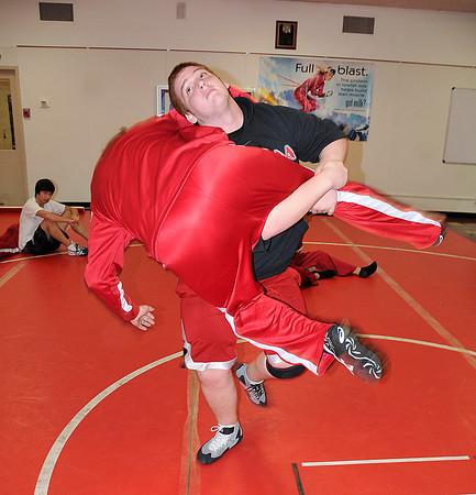 James Neiss/staff photographerNiagara Falls, NY - Niagara Catholic wrestler Jordan Denney takes down teammate Tim McCarthy during practice.