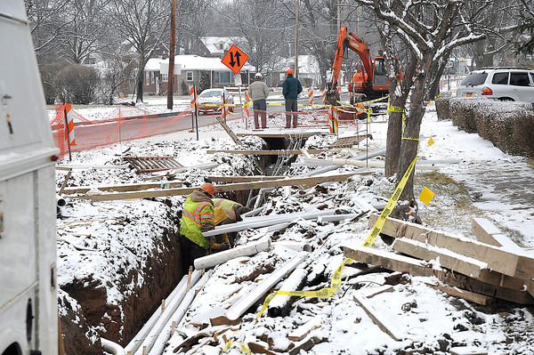 James Neiss/staff photographerNiagara Falls, NY - Workers from Custom Crews are lowering telecommunication line in the 3900 block of Lewiston Road on Thursday.