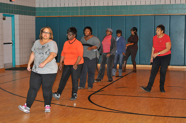 "James Neiss/staff photographerNiagara Falls, NY - Joan ""Lady J"" Harris, right, teaches the Wednesday dance class a few line dance moves at the Doris W. Jones Resource Building."