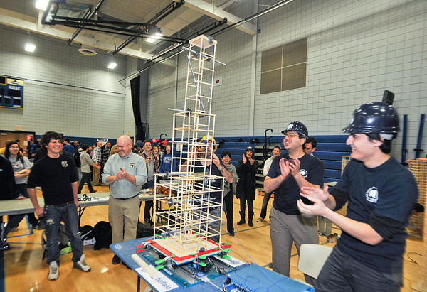 James Neiss/staff photographerSanborn, NY - Joe Zientrara of Lewiston-Porter High School, left, is all smiles after his building survived a sever shaking by UB Civil Engineers students during the Seismic Design competition at the 2012 Tech Wars at Niagara County Community College.