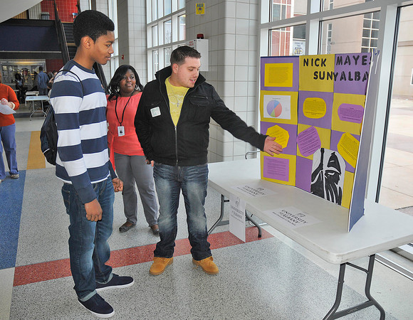 James Neiss/staff photographerNiagara Falls, NY - Niagara Falls High School student Isaac Jordan, 17, and Career Center Director Schurron Cowart, listen to 2011 graduate Nick Mayes who came back for the day to talk about his experiences at SUNY Albany. NFHS graduates came back to participate in Alumni Day at the high school, giving students an opportunity to have conversations with alumni about life after high school.