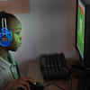 James Neiss/staff photographerTown of Niagara, NY - Kindergarten student Zyeir Isom works on his phonics skills on the computer at the Niagara Charter School work on a reading lesson during class.