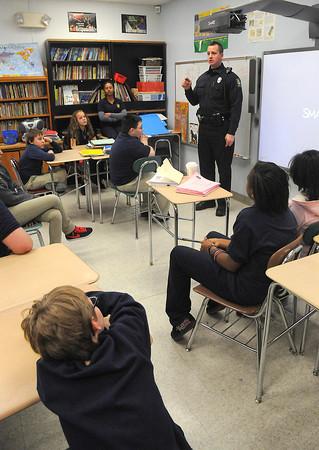James Neiss/staff photographerNiagara Falls, NY - Niagara Falls Police Officer Dave Cudahy tells students every body deserves to feel happy, during an anti-bullying talk at Henry J. Kalfas Magnet School.