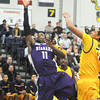 James Neiss/staff photographerBuffalo, NY - Niagara University #11 Ameen Tanksley putts the ball up during basketball game action at Canisius.