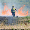 James Neiss/staff photographerWheatfield, NY - Bergholtz and Frontier volunteer fire companies responded to a field fire on the southeast corner of Williams Road and Lancelot Drive in the Town of Wheatfield. The burning sun dried straw sent plums of black smoke into the air that could be seen for miles around.