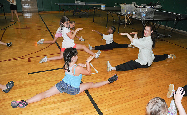 James Neiss/staff photographerNiagara Falls, NY - Master Erin Markle of the gold Summit Martial Arts Institute teaches a Kung-FU class to students participating in the Confucius Institute summer camp at Lewiston-Porter Intermediate, sponsored by Lew-Port and the University at Buffalo.