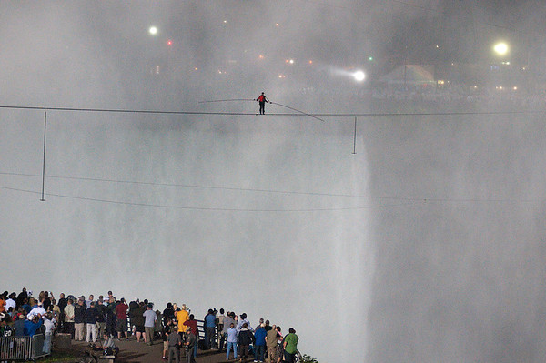 James Neiss/staff photographerNiagara Falls, NY - Daredevil Nik Wallenda walks his high wire across the Niagara Gorge on June 15, 2012. The aerialist and the city are in discussions over a disagreement on the cost of services rendered by the city.