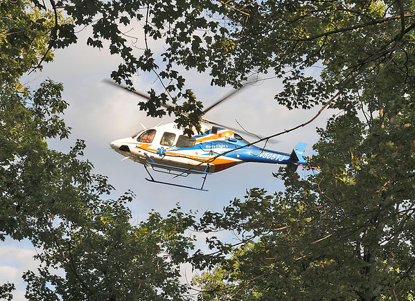 James Neiss/staff photographerNiagara Falls, NY - Mercy Flight looks for a landing site near rescue efforts by Niagara Falls Firefighters and New York State Parks Police to bring up a falling victim who fell approximately 60 - 70 feet down from the rim between Whirlpool and Devils Hole state parks. The victim was reported to have several lacerations and broken bones.