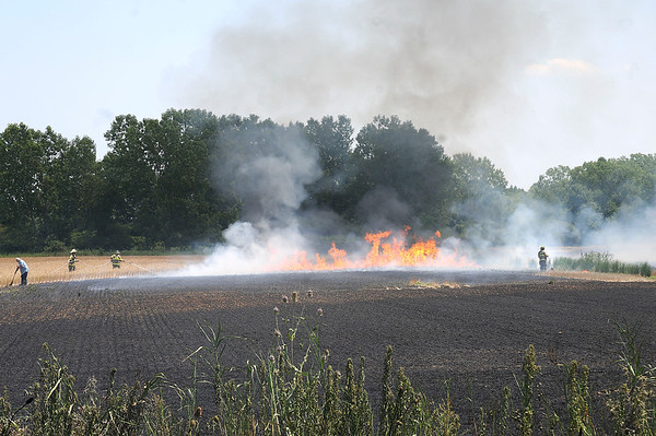 James Neiss/staff photographerWheatfield, NY - Bergholtz and Frontier volunteer fire companies responded to a field fire on the southeast corner of Williams Road and Lancelot Drive in the Town of Wheatfield. The burning sun dried straw sent plumes of black smoke into the air that could be seen for miles around.