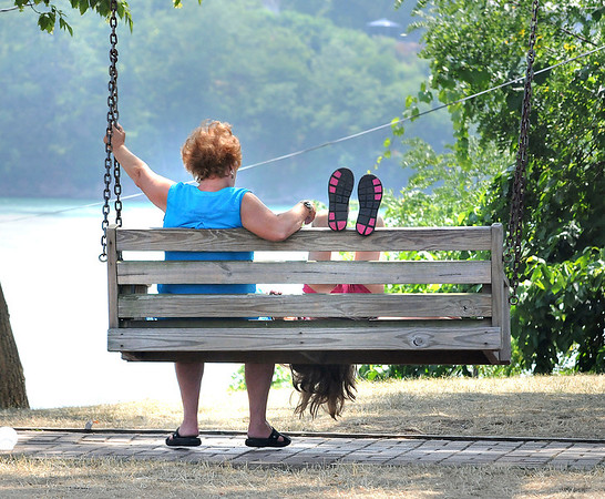 James Neiss/staff photographerLewiston, NY - Perspective: Little Chloe Tullius, 10 of Amherst, decided to take in the sights at Lewiston Landing upside down while swinging with Coralee Smith, left, also of Amherst.