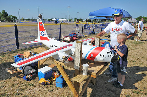 James Neiss/staff photographerNiagara Falls, NY - Six year old Cameron Covert helps his dad Duane fuel up their Coast Guard C130 during the Fly Over Niagara Radio Control & Control Line Combat Airshow at Reservoir State Park. The event continues Sunday from 10 a.m. - 4 p.m. and is open to the public.