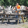James Neiss/staff photographerNiagara Falls, NY - City skilled trades worker Kenny Redell had a nice sunny day to make picnic table repairs at Hyde Park. Redell, said he had over 20 tables lined up for repair.