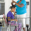 James Neiss/staff photographerNiagara Falls, NY - All about the Weave: Jada Smith, 19, tries to be patient as her step-sister Jessica Winkfield, 24, installs hair extensions on their Linwood Avenue porch. The duo said it was cooler to do it outside because of Wednesdays warm weather.