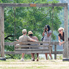 James Neiss/staff photographerLewiston, NY - Sue Weaver of Delaware, right, tries to get the attention of her son P.J. his wife Tiffani, and their children Sonny and Teddi, as Aunt Yolanda Williamson of Wheatfield takes a snapshot during an outing to Lewiston Landing. The Weaver's were all visiting from Delaware.