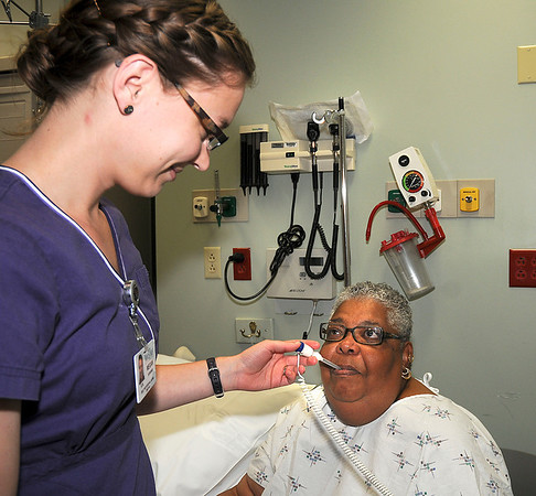 James Neiss/staff photographerLewiston, NY - Nurse Megan Stevens, RN, takes Mae Ellen Nix's temperature during a visit to the emergency room.  Mount St. Mary's was ranked in the top 10 safest hospitals by Consumer Reports.
