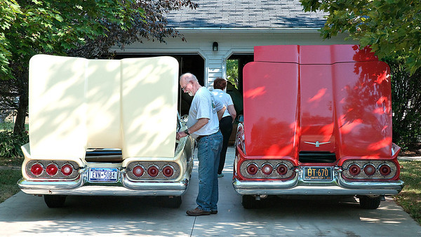 James Neiss/staff photographerYoungstown, NY - Tom Patrick had a beautiful summer morning to work on the convertible top mechanisms on his dual 1960 Ford Thunderbirds in front of his Brookshire Road home.