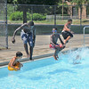 James Neiss/staff photographerNiagara Falls, NY - Splashing Good Time: A group of boys stayed cool and had some summertime fun by jumping into the water at the Center Court Pool.
