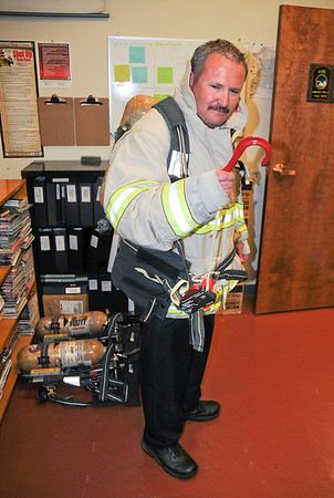 James Neiss/staff photographerNiagara Fals, NY - Niagara Falls Fire Chief Thomas Colangelo shows off a SCOTT EZ-Scape Fire Fighter Self-Rescue Accessory, new equipment bought with funding approved by the City Council that also includes training of the new devices. The new equipment will allow a firefighter to escape a burning building from upper story windows in an emergency.