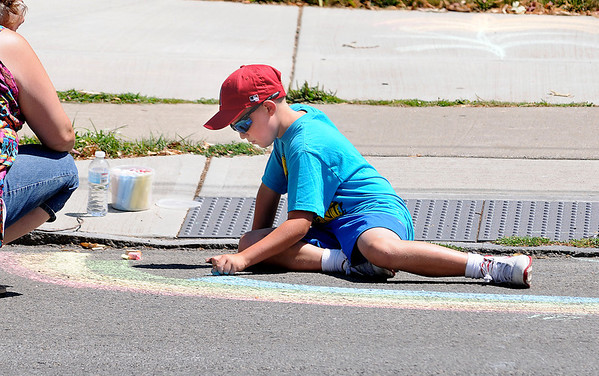 James Neiss/staff photographerNiagara Falls, NY - Tyler Walker, 9, makes a chalk rainbow on Portage Road during Arts in the Park between the Niagara Falls Memorial Medical center and Niagara Arts and Cultural Center.