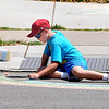 James Neiss/staff photographerNiagara Falls, NY - Tyler Walker, 9, makes a chalk rainbow on Portage Road during Arts in the Park between the Niagara Falls Memorial Medical center and Niagara Arts and Cultural Center.