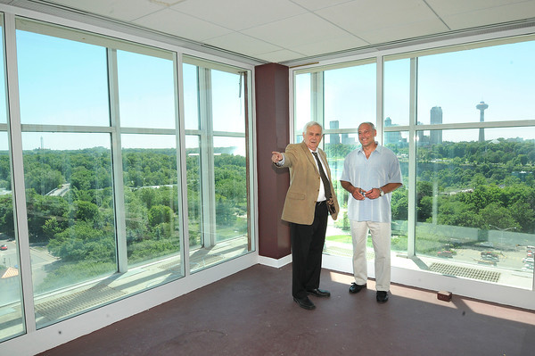 James Neiss/staff photographerNiagara Falls, NY - One Niagara Managing Partner Paul Grenga, right, and President Tony Farina are getting ready for their own balancing act of fun and entertainment as they prepare the top floor so guests can view a portion of the Nik Wallenda high-wire walk on Friday.
