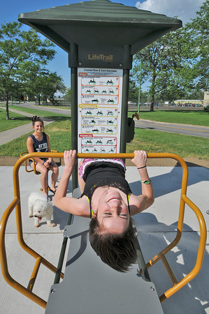 James Neiss/staff photographerNiagara Falls, NY - Feel the Burn: Christina Olszewski with her dog Zack, watches her friend Lauren Krulisky do some exercises at Hyde Park. The station is one of 4 new senior friendly exercise stations on the 1 mile Niagara Elders Exercise Loop,  from the John Duke Senior Center, through Hyde Park.