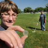 James Neiss/staff photographerNiagara Falls, NY - Tourist Nikki Nichols shows off a 1934 penny she found at Hyde Park  where her and boyfriend Robert Poling were looking for buried treasures with metal detectors. The couple from Chillicothe, Ohio, were pursuing a hobby they rarely have time for after visiting Niagara Falls State Park earlier in the day.