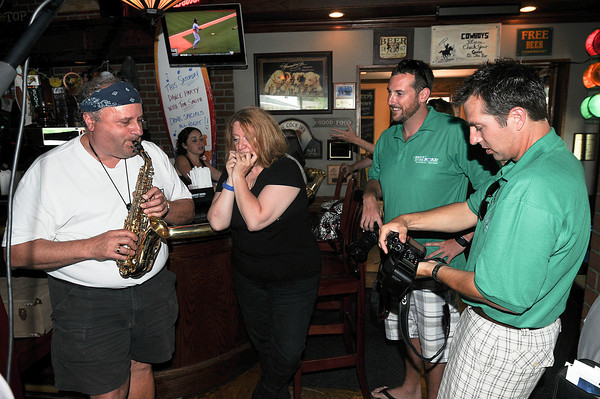 "James Neiss/staff photographerNiagara Falls, NY - Travel bloggers Brian Cox and Mike Shubic were greeted by entertainers Joe Malvestuto and Marcia Jones at The Brickyard in Lewiston. Cox and fellow travel blogger Mike Shubic are traveling the country as part of the ""Best of the Road"" contest sponsored by Rand McNally and USA Today. The two writers put their taste buds to the test visiting local eating establishments in Lewiston on Thursday."